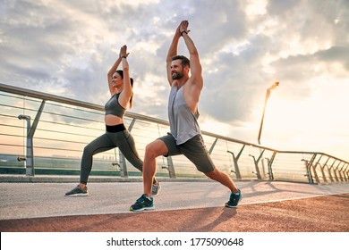 Couple doing sport together on the street. Yoga in the morning - Shutterstock ID 1775090648