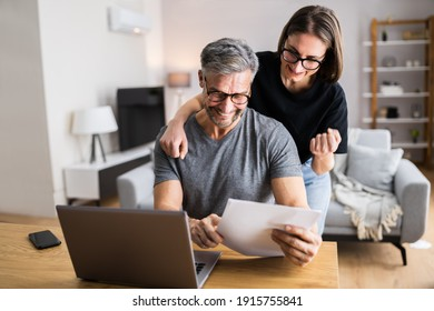 Couple Doing Taxes And Family Budget On Computer