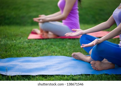 couple doing yoga outdoors