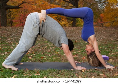 couple doing yoga in the park