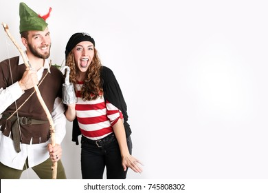 Couple dressed up for Halloween as Robin Hood and a Pirate