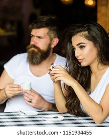Couple drink black espresso coffee in cafe. Couple enjoy hot espresso. Having black cup of coffee when feel tensed or low can boost your mood instantly make things better. Morning coffee tradition.