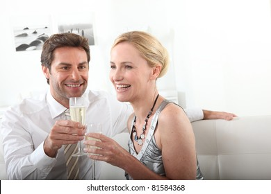 Couple drinking champagne at home