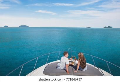 couple drinking champagne on luxury yacht cruise, luxurious lifestyle