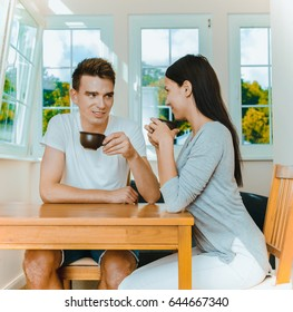 Couple drinking coffee.