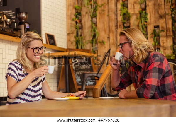 Couple drinking espresso in the cafe