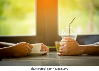 couple drinking hot and cold coffee