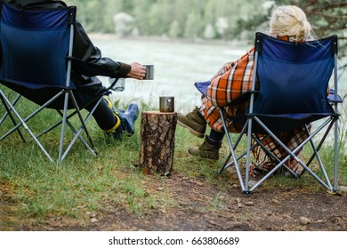 Couple drinking tea in the forest. Rest and relaxation.