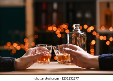 Couple drinking whiskey in bar