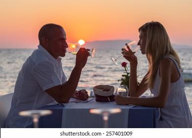 Couple drinking wine at sunset