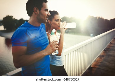 Couple drinks water to replenish energy and to hydrate