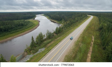 Couple driving a van, while living the vanlife near Hay River, Northwest Territories, Canada.