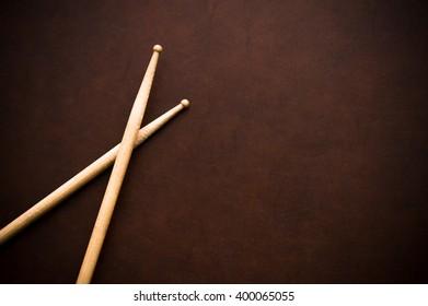 Couple of drum sticks on wooden desktop background