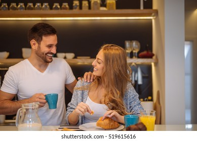 Couple eating a breakfast together at home.