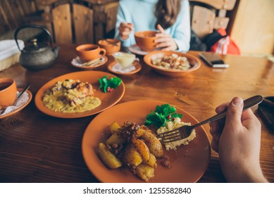 couple eating in cafe. first person point of view. lifestyle. man hand holding fork