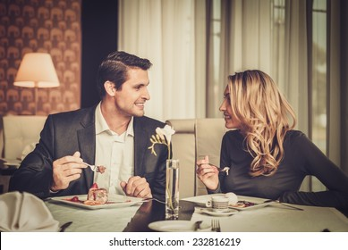 Couple eating dessert in a restaurant