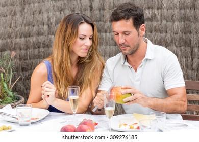 Couple eating fruits outside