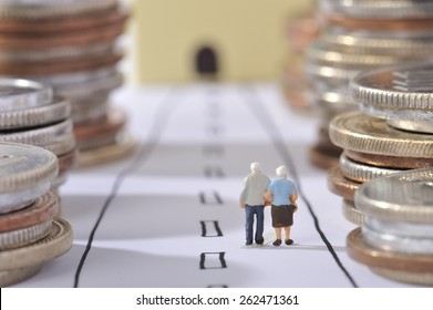 Couple of elderly walking the road surrounded by money