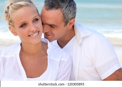 Couple embracing by the sea