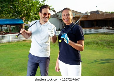 Couple embracing on the golf course