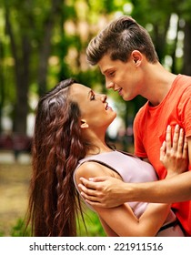 Couple  embracing at park. Summer outdoor.