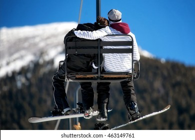 A couple embracing as they ride on a ski lift in Flagstaff, Arizona, USA