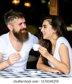 Couple enjoy hot espresso. Couple in love drink black espresso coffee in cafe. Romantic date in cafe. Drinking black coffee improves your mood and thus makes you happy. Pleasant coffee break.