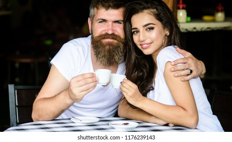 Couple enjoy hot espresso. Couple in love drink black espresso coffee in cafe. Romantic date in cafe. Pleasant coffee break. Drinking black coffee improves your mood and thus makes you happy.