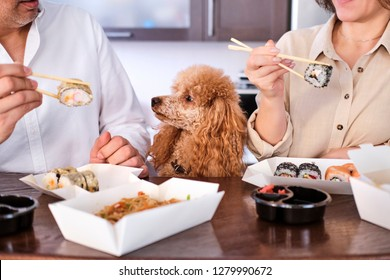Couple enjoy japanese thai meal at home.  Concept of takeaway delivery service.