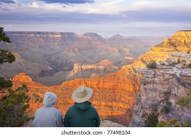 Couple Enjoying the Beautiful Landscape of the Grand Canyon Sunset.