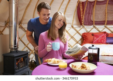Couple Enjoying Camping Holiday In Traditional Yurt