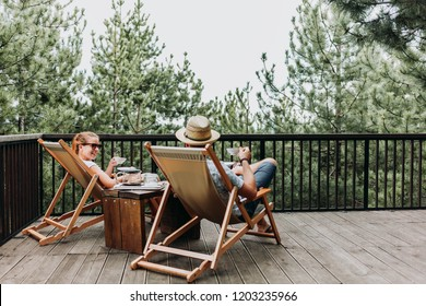Couple enjoying coffee on a balcony in the mountains