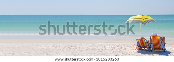 Couple Enjoying a Day at the Beach. Horizontal Banner with Copy Space