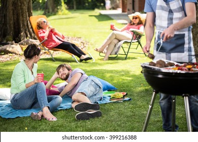Couple enjoying free time on a picnic in park