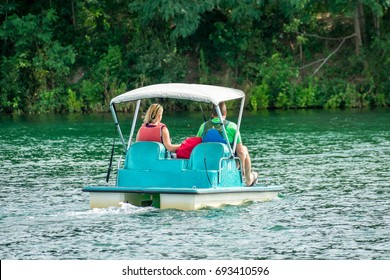 Couple enjoying a leisurely paddle on the weekend