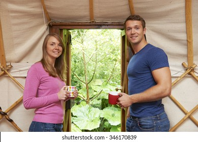 Couple Enjoying Luxury Camping Holiday In Yurt