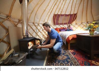 Couple Enjoying Luxury Camping Holiday In Yurt
