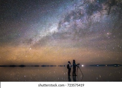 A Couple Enjoying Milky Way at Salt Flat, Salar de Uyuni, Bolivia