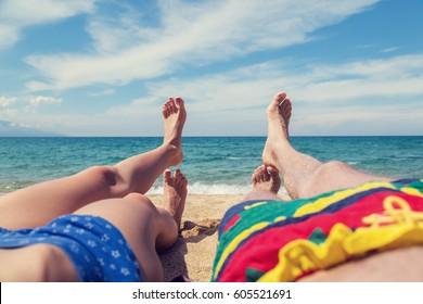 Couple enjoying on the sandy ocean / sea beach.