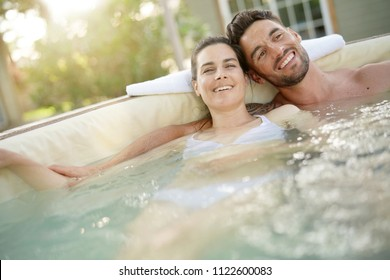 Couple enjoying relaxing time in hot tub water