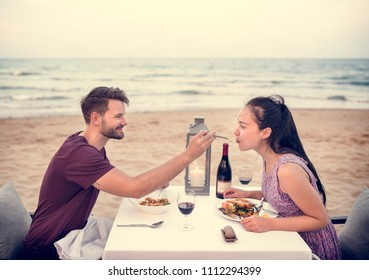 Couple enjoying a romantic dinner at the beach