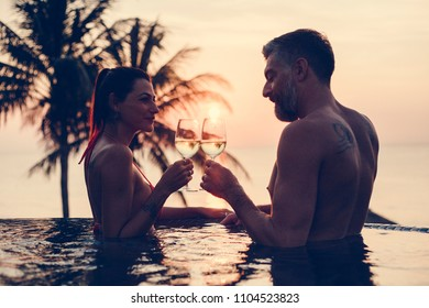 Couple enjoying a romantic sunset