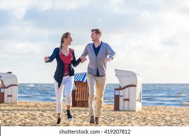 Couple enjoying romantic sunset at German north sea beach
