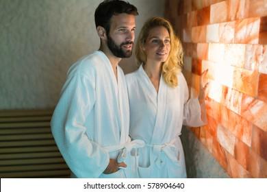 Couple enjoying salt room therapy at spa resort