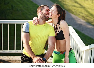 Couple is enjoying sunny day and exericsing.