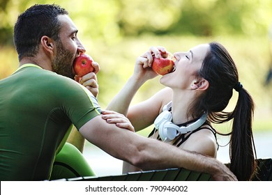 Couple enjoying sunny day and relaxing after joging.