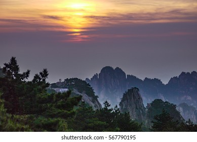 Couple enjoying the sunset light over the Huangshan mountains in China
