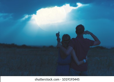Couple enjoying under the moonlight in nature. My astronomy work.