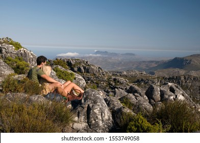 Couple enjoying the view from the top of Table Mountain, Cape Town