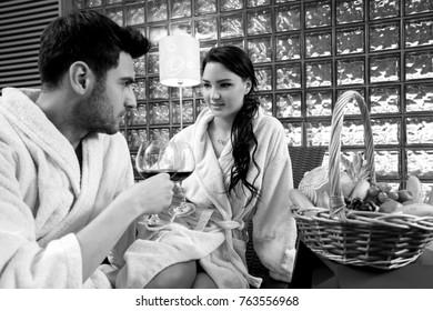 Couple enjoying in wine and fruit. luxury